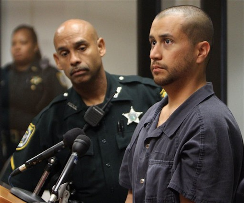 In this Thursday, April 12, 2012 file photo, George Zimmerman, charged with killing 17-year-old Trayvon Martin, right, stands next to a Seminole County Deputy during a court hearing in Sanford, Fla. A judge on Friday, June 1, 2012 revoked Zimmerman's bond and ordered him returned to jail within 48 hours. Circuit Judge Kenneth Lester said Zimmerman misled the court about how much money he had available when his bond was set for $150,000 in April. Prosecutors claim Zimmerman had $135,000 available that had been raised by a website he set up. (AP Photo/Gary W. Green, Orlando Sentinel, Pool)