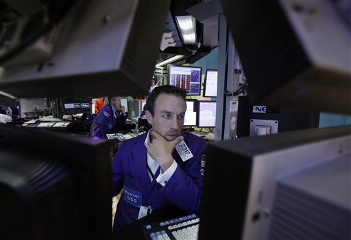 FILE - In this June 1, 2012 file photo, Specialist Christopher Trotta is framed by screens as he works at his post on the floor of the New York Stock Exchange. U.S. stock futures are rebounding Monday, June 4, 2012, from a 275-point plunge Friday even with markets in Europe and Asia slumping. (AP Photo/Richard Drew, File)