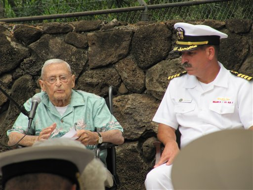 In this photo taken June 1, 2012, retired Rear Adm. Mac Showers, left, the last surviving member of the intelligence team that deciphered Japanese messages in the lead up to the Battle of Midway, speaks during a ceremony in Pearl Harbor, Hawaii. Listening at right is Capt. James Fannell, the Pacific Fleet's deputy chief of staff for intelligence. On Monday, June 4, 2012, Showers and Navy officials are observing the 70th anniversary of the battle that changed the course of World War II. (AP Photo/Audrey McAvoy)