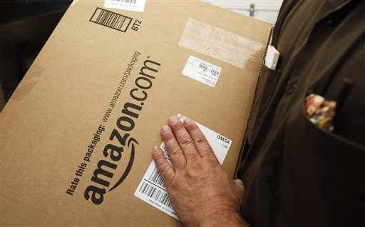 An Amazon.com package is prepared for shipment by a United Parcel Service driver in Palo Alto, Calif. The proposed Marketplace Fairness Act would require online merchants to collect sales taxes, just as their brick and mortar competitors have to do.