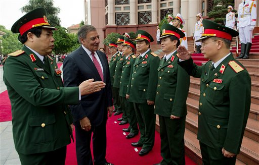 U.S. Defense Secretary Leon Panetta, second left, participates in an arrival ceremony with Vietnamese Defense Minister Phung Quang Thanh, left, at the Ministry of Defense in Hanoi, Vietnam Monday, June 4, 2012. (AP Photo/Jim Watson, Pool) HORIZONTAL