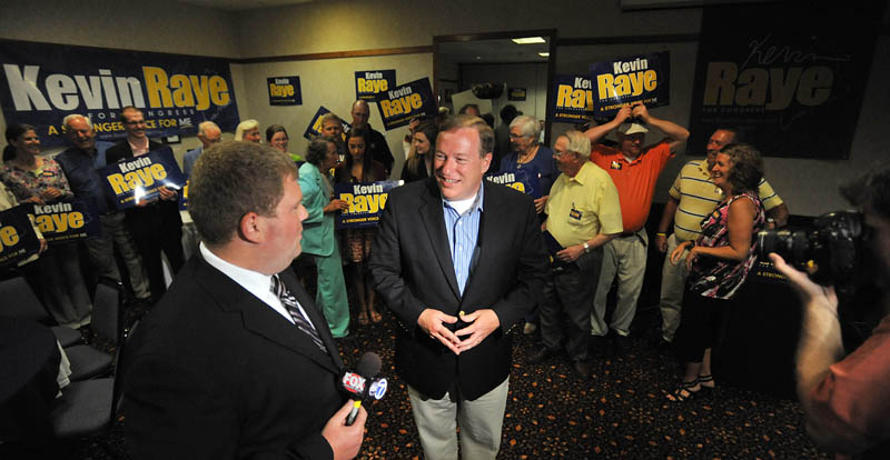 Staff photo by Michael G. Seamans Kevin Raye, candidate for US second congressional district, gives an interview in front of supporters at the Ramada Inn in Bangor Tuesday night.
