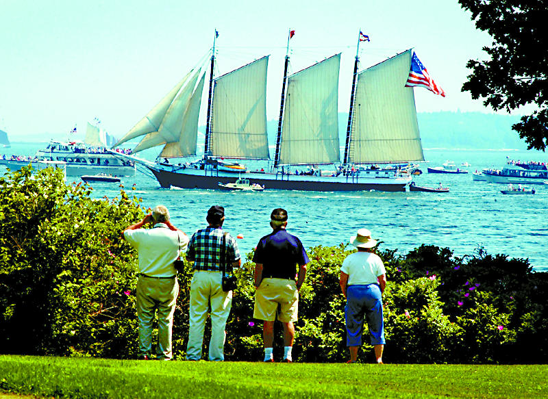 In this June 2003 file photo, the schooner Victory Chimes makes her way past visitors from New York and Florida as she closes in on Boothbay Harbor and the 41st annual Windjammer Days festivities in Boothbay Harbor.