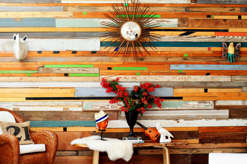 Sarah Reiss uses wood from gymnasiums, bowling alleys and barns, as well as shiplap, to craft her wall art and tables.