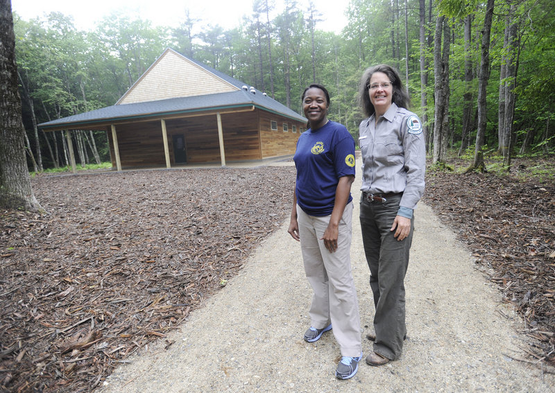 Lisha Wedderburn, left, an environmental educator with the Maine Conservation Corps, and Jocelyn Hubbell, interpretive specialist with the Maine Bureau of Parks and Lands stand outside the new nature center.