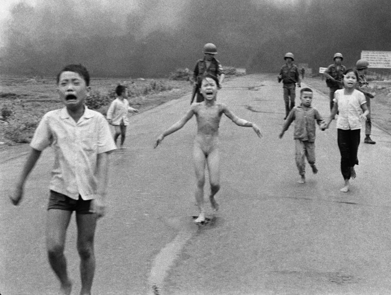 In 1972, Phuc became a tragic symbol of the Vietnam War when she was photographed running down a South Vietnamese road after a napalm attack.