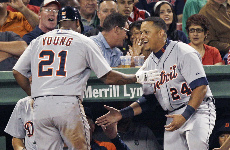 Delmon Young gets congratulated by Miguel Cabrera after a solo home run in the eighth inning Thursday night in Boston. The Tigers won 7-3 to avoid a four-game sweep.