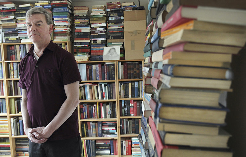 Mike Donovan, shown in his home office in Brookline, Mass., one of the pillars of the Boston comedy scene, says his book is a general history of the United States with a touch of humor.