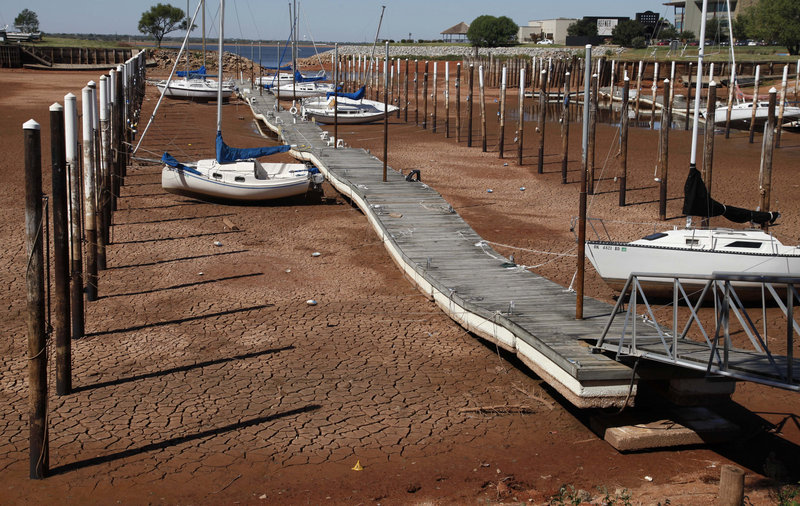 Sailboats sit on the parched floor of Lake Hefner in Oklahoma City last September during a blistering heat wave. Oklahoma averaged 86.9 degrees last summer.