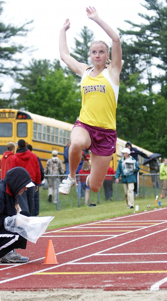 Marie Vermun of Thornton Academy sails into the long jump pit Saturday at the Class A track and field meet. Vermun finished second behind Tiffany Gray of Bangor.