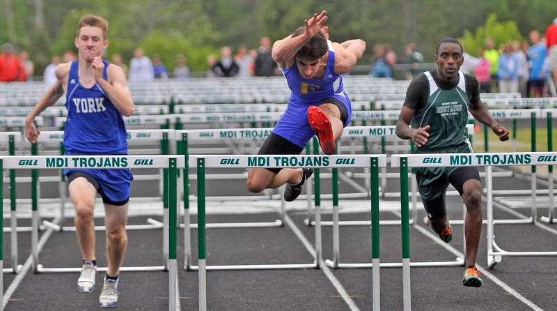 Reid Pryzant of Falmouth was second in the 110 hurdles in Class B. Tom York, left, of York was third and Curtis Griffin of Mt. View, right, was fourth. Ethan Hutchins of Spruce Mountain won.