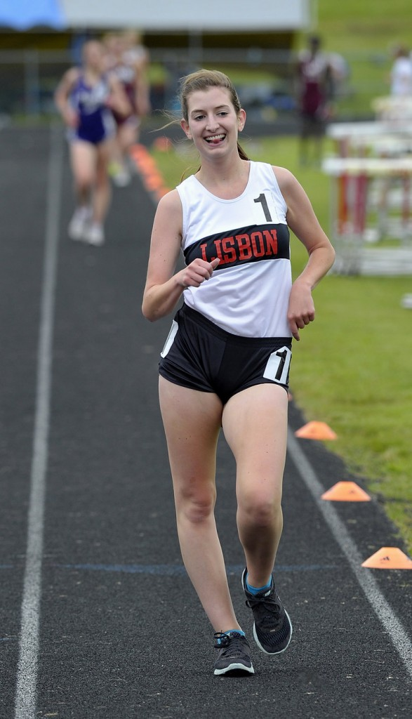 Lindsey Whitney of Lisbon is all smiles while easily winning the 1,600 racewalk in a time of 8 minutes, 20.8 seconds – almost 15 seconds in front.