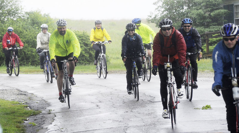 Bikers head out from Wells Reserve at Laudholm Farm for a ride that took place in record-setting rain that forced cancellation of the longest route, 100 miles, for safety reasons.