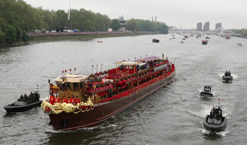 The royal barge, transporting Queen Elizabeth II and her family, approaches Chelsea Bridge in London during the Diamond Jubilee River Pageant on Sunday.