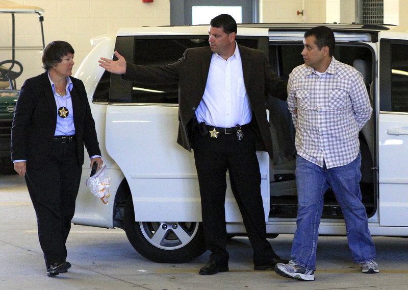 George Zimmerman, right, who faces a second-degree murder change in the killing of Trayvon Martin, returns to the John E. Polk Correctional Facility in Sanford, Fla., on Sunday.