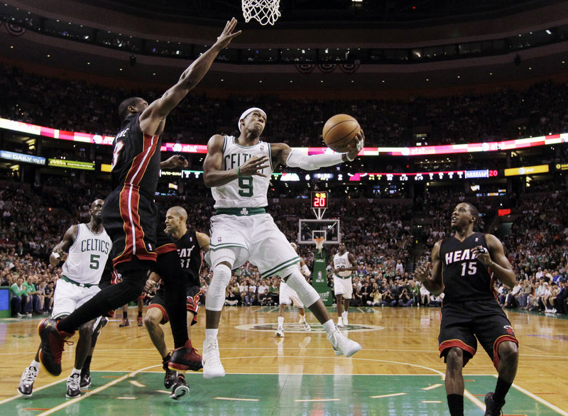 Rajon Rondo drives against Miami's Dwyane Wade during Game 4 of the Eastern Conference finals Sunday night in Boston. Rondo scored 15 points – including the final three in overtime – and added 15 assists as the Celtics evened the series with a 93-91 victory.