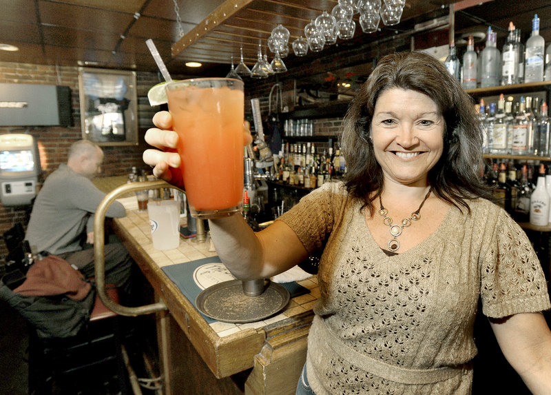Bartender Barbi Asali with a tequila sunrise at Rosie's Restaurant & Pub.