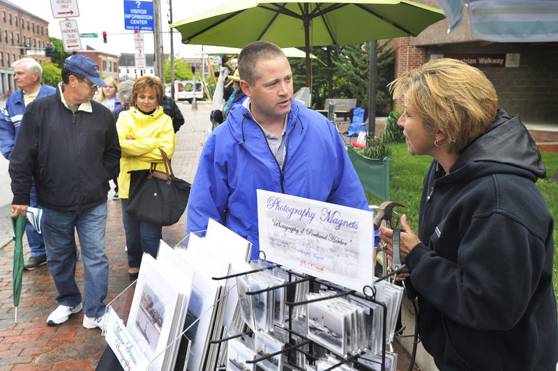 Portland Code Enforcement Officer Chuck Fagone talks with Tara Michaud about regulations for street vendors using city sidewalks to sell their wares to cruise ship passengers.