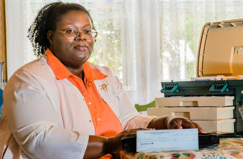 Leslie Gilbert of Grand Rapids, Mich., a former employee of Focus Care Home Health, displays the check she received for back wages. The check was not signed and for the incorrect amount and had to be returned.
