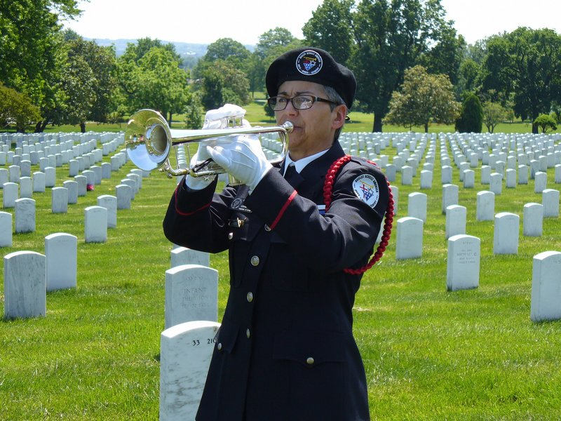 "Carla Beaudoin joined other members of Bugles Across America May 19 to play ""Taps"" at Arlington National Cemetery in celebration of the 150th anniversary of the piece."