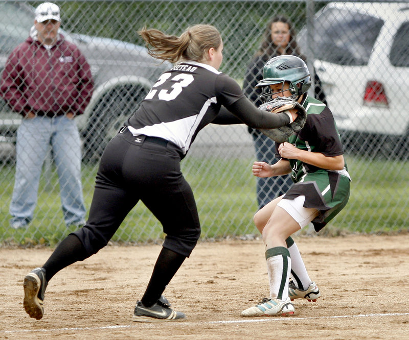 Heather Fecteau of Biddeford tags out Danielle Day, who was trying to score on a bunt for Bonny Eagle in the sixth inning.