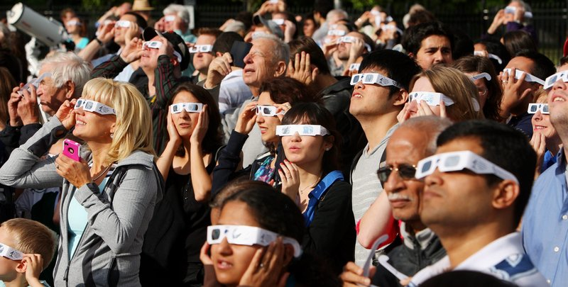 Venus viewers wearing special glasses to protect their eyes from the sun gather to watch the transit of Venus at the University of Western Ontario in London, Ontario, on Tuesday. The planet's trip across the face of the sun was the last that will be visible for another 105 years.