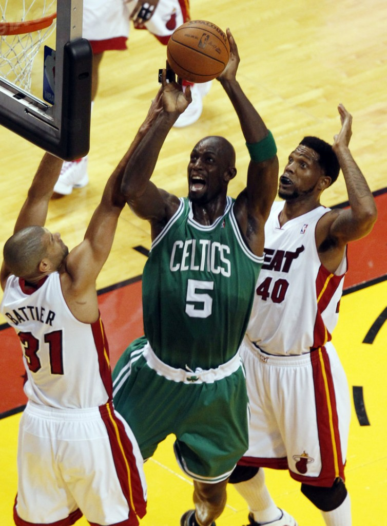 Kevin Garnett, a force Tuesday night for the Boston Celtics with 26 points and 11 rebounds, drives against Shane Battier, left, and Udonis Haslem of the Miami Heat.