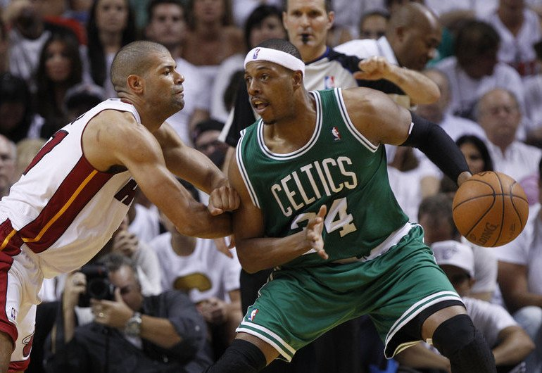 Paul Pierce of the Boston Celtics maneuvers his way to the basket around Shane Battier of the Miami Heat in this 2014 photo.