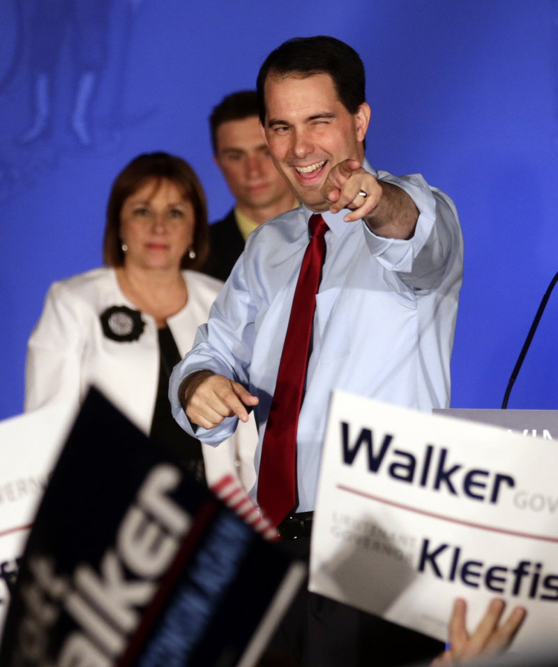 Wisconsin Republican Gov. Scott Walker reacts at his victory party Tuesday in Waukesha, Wis., after defeating Democratic challenger Tom Barrett in a recall election. In almost all respects, the voters Tuesday resembled those of the 2010 election, only there were more of them.