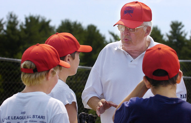 Ron Farr works with members of an all-star team at practice at the Portland North Little League field at Lyman Moore Middle School prior to their first game in July 2006. Overall, Farr has coached 20 all-star teams for the league.