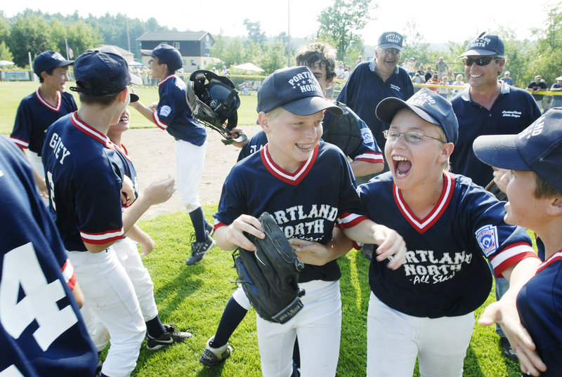 Luke Boyle and Tyler Wiggin and their Portland North Little League team celebrate their state championship victory over Lincoln County in 2007. Coach Ron Farr stands in the background. In two weeks, Farr will coach a Portland North all-star team for the 13th consecutive year.