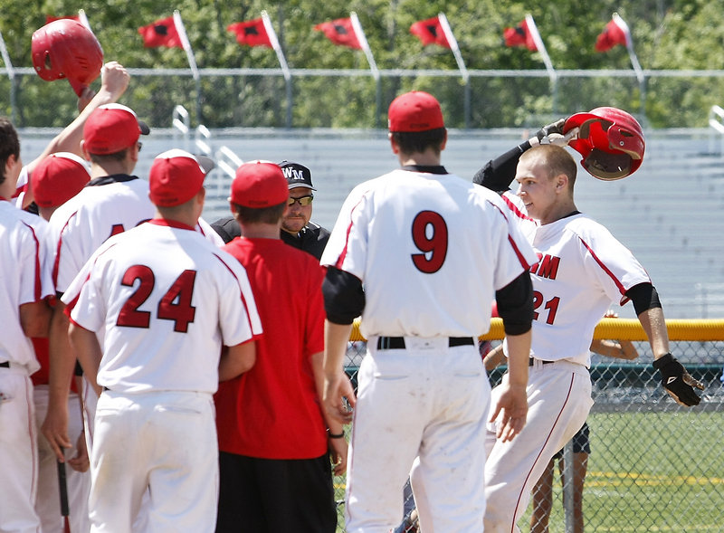 Ben Wessel is greeted by his Scarborough teammates Saturday after hitting a three-run homer in the fifth inning of the 7-0 victory over Windham. The Red Storm will meet Cheverus for the Western Class A title.