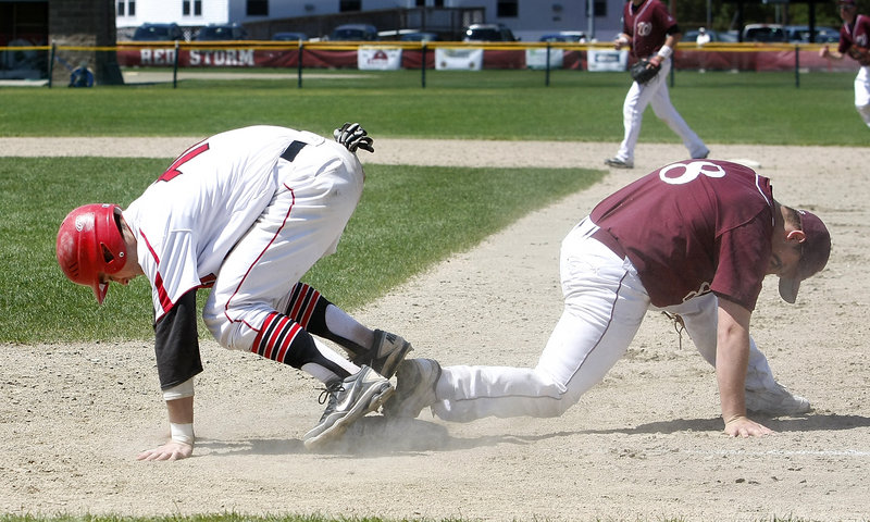 Robbie Hamilton, right, of Windham keeps his foot on the first-base bag and gets the out on Conor McCann of Scarborough to complete a double play Saturday in the fifth inning of Scarborough's 7-0 victory in a Western Class A baseball semifinal.