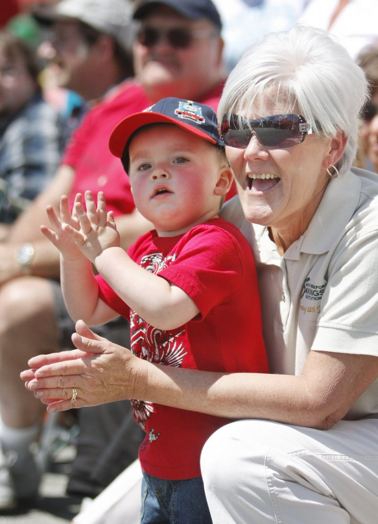 Leeland Binette, 2, of Biddeford watches the floats as they pass by him and his grandmother, Lynne Belanger, also of Biddeford.