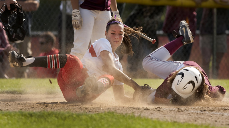 South Portland pitcher Erin Bogdanovich tags out Thornton's Sam Schildroth, who was trying to score on a passed ball. South Portland advanced to the regional final with an 8-1 win.