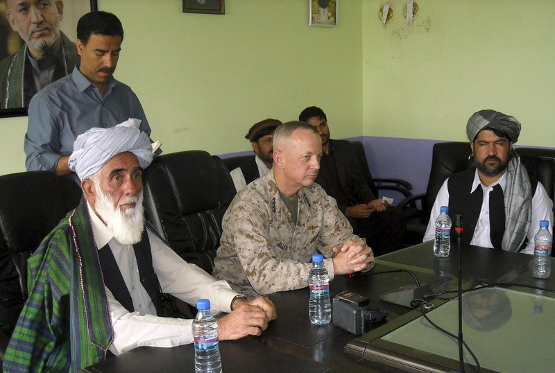 Gen. John Allen, center, commander of Western forces in Afghanistan, meets with Allhaj Mohammad Tahir Sabari, governor of Logar province, on Friday. NATO reached an agreement Saturday not to bomb residential buildings.