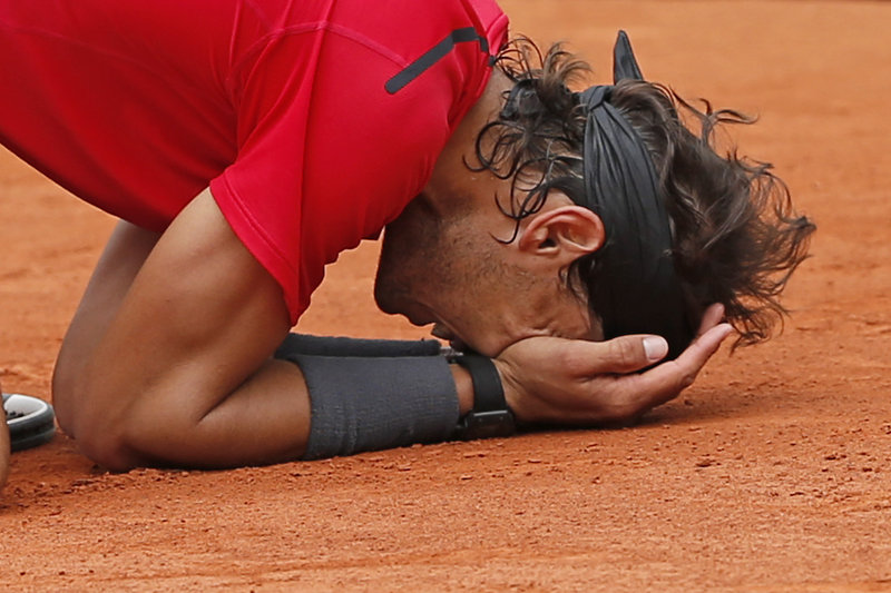 "Rafael Nadal of Spain savors the moment Monday after winning the men's final match against Novak Djokovic of Serbia at the French Open in Paris. ""When you lose, it's because you don't deserve the title,"" he said. ""So in my mind, this was the final I had to win. That's why I was so emotional."""