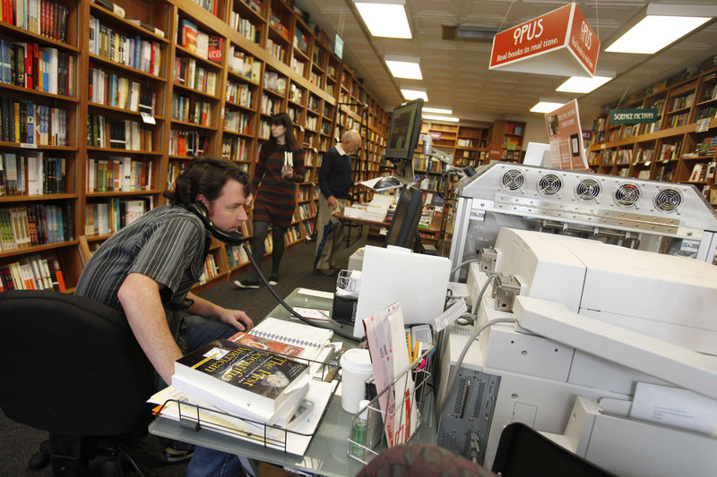 "Bill Leggett works on the Espresso Book Machine, nicknamed ""Opus,"" at Politics and Prose bookstore in Washington, D.C. Self-publishing and copying out-of-print editions have been made easier since the machine by On Demand Books debuted in 2006."