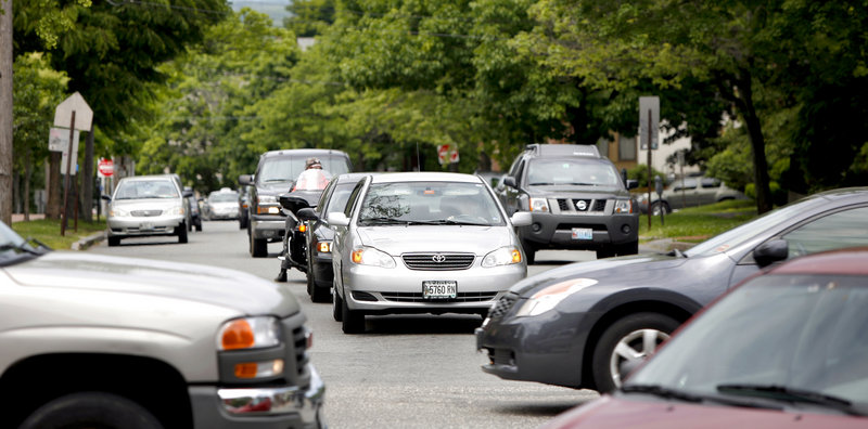 Cars are stopped on State Street at the intersection with Congress Street in Portland on Monday. A plan to make the street two-way could make it more pedestrian-friendly.