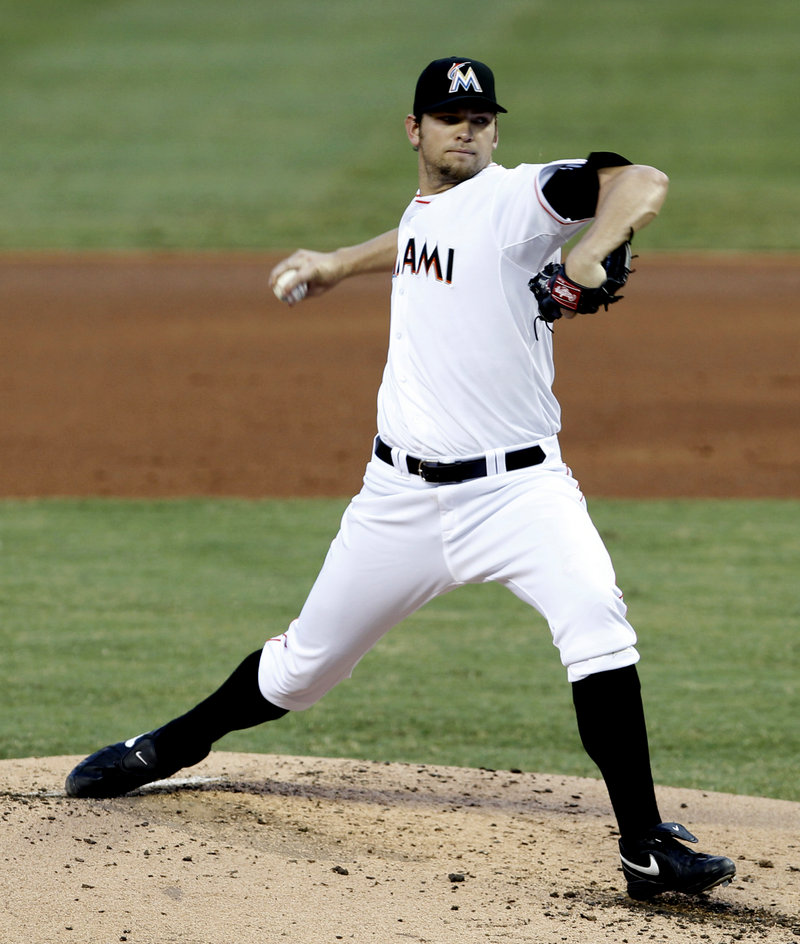 Josh Johnson allowed just four hits and one run in seven innings Monday as the Marlins ended a six-game losing streak with a 4-1 victory over the Red Sox.