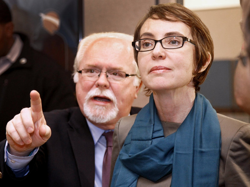 Then-U.S. Rep. Gabrielle Giffords and Ron Barber visit an agency in Tucson, Ariz., in January. Barber, who is Giffords' choice to succeed her in the House, battled one of her former rivals in a special election Tuesday.