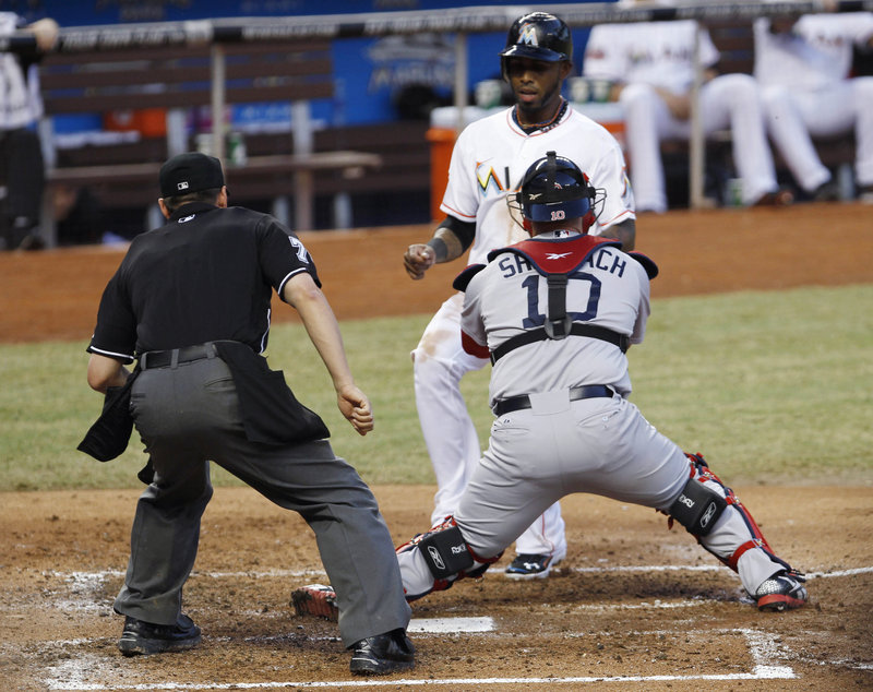 Boston Red Sox catcher Kelly Shoppach tags out the Miami Marlins' Jose Reyes trying to score from second on an infield single by Hanley Ramirez in the third inning of the Red Sox's 2-1 win Tuesday night.