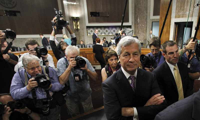 JPMorgan Chase CEO Jamie Dimon arrives on Capitol Hill Wednesday to testify before the Senate Banking Committee.