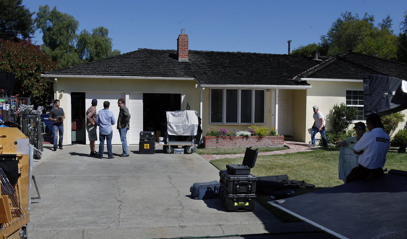 "A vertical garage door is replaced with sliding doors at Steve Jobs' childhood home in L.A. as filmmakers prepared this week to begin shooting the feature film ""jOBS."""