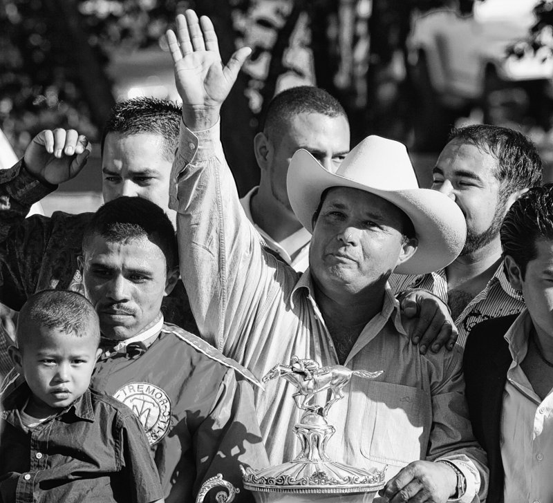 Jose Trevino Morales, center, acknowledges the crowd after one of his horses won a race in New Mexico in 2010.