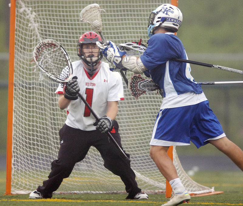 Scarborough goalie David Pearson braces for a shot by Kennebunk's Harrison Hall. Pearson limited Kennebunk to three goals as Scarborough advanced to another state final.
