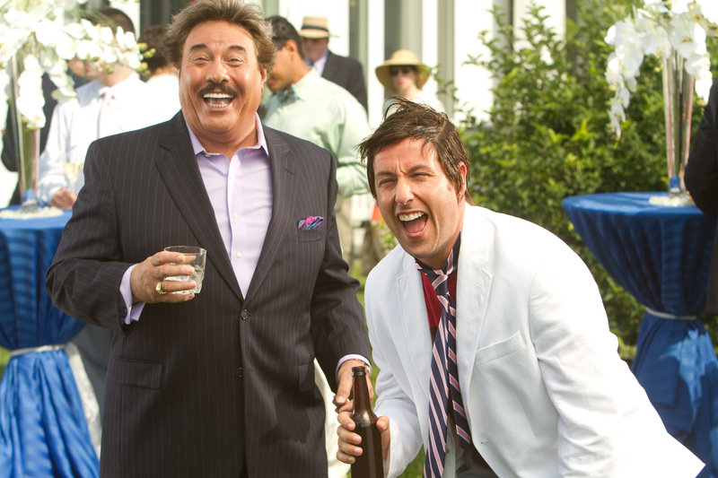 """Tony Orlando, left, plays the rich, crude and self-indulgent boss of the son of slacker Adam Sandler, right, in a scene from the movie """"That's My Boy."""""""