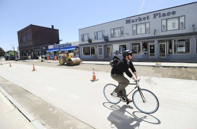 Michael Drinan, the owner of the Market Place building, above, and other business owners collected 600 signatures in favor of maintaining angled parking on Ocean Street, to no avail.
