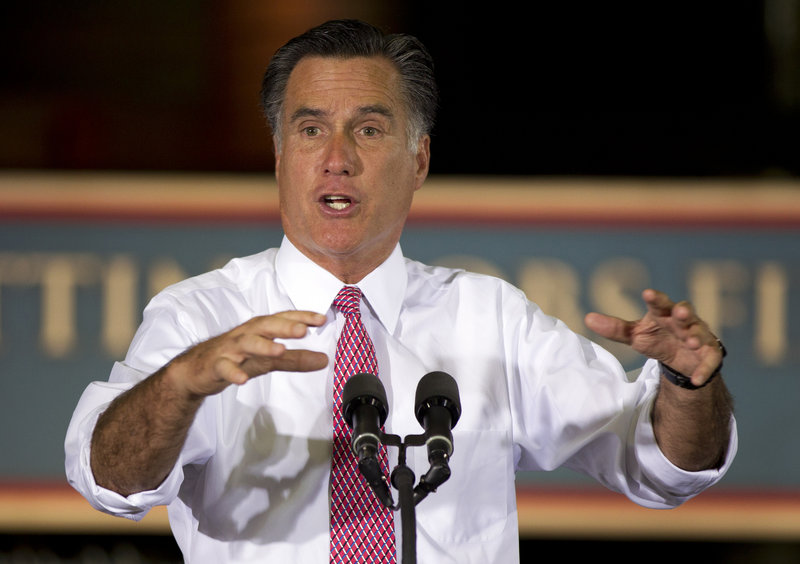 Republican presidential candidate Mitt Romney gestures during a campaign stop at Seilkop Industries in Cincinnati, Ohio, on Thursday.
