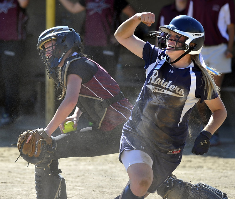 Maggie McConkey celebrates after scoring Fryeburg's first run Thursday, starting an eight-run rally in the fourth inning that gave the Rangers an 8-1 win over Greely.